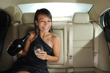 Are passengers allowed to consume alcohol inside a car?